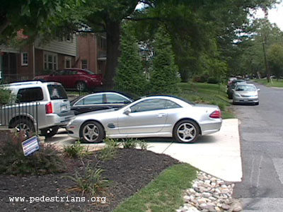 Cars overflow driveway